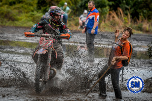 WIld Boar GNCC 2017 Tina Wicker getting splashed during the race as she pointed lines to racers.... Truly Dedicated!